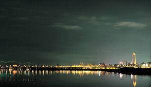 Seaside city dazzling light night business ppt template